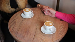Two cups of coffee with a pattern on a table Stock Footage