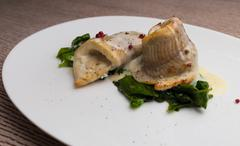 Fish fillets in creamy sauce Stock Photos