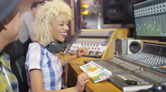 4K Professional team in recording studio mixing a track with male vocalist Arkistovideo