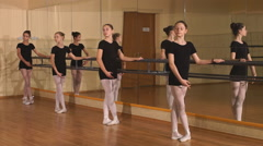 Group of eight young ballerinas standing in row and practicing ballet. girls Stock Footage