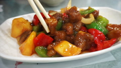 Chopsticks eating sweet and sour pork in Hong Kong restaurant, Chinese cuisine Stock Footage