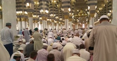 Muslims praying and reading Quran inside Nabawi mosque Stock Footage