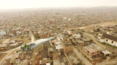 AERIAL of flying over Slums in Lima, Peru. South America. Stock Footage