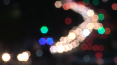 Heavy traffic at night with car headlights out of focus Stock Footage