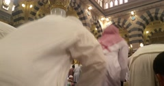 , Muslims praying and reading Quran inside Masjid (mosque) Nabawi Stock Footage