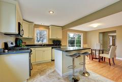 Open floor plan white kitchen room interior with island and dining area. Nort Stock Photos