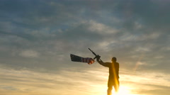 Soldier waving american flag and holding rifle. Stock Footage