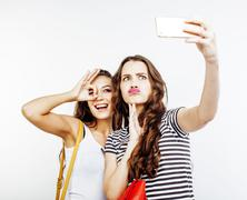 Two best friends teenage girls together having fun, posing emotional on white Stock Photos