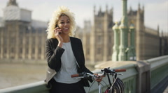 4K Portrait smiling London businesswoman talking on phone outdoors in the city.  Stock Footage