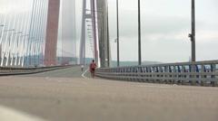 Runners are running over the bridge. Marathon concept Stock Footage