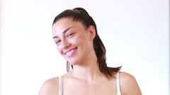 Portrait of smiling woman without makeup on white background Stock Footage