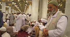Muslims praying inside masjid.  Stock Footage