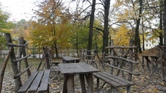 Benches in the park on fall day Stock Footage