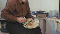 The old man artist painting Stock Footage