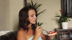 Young Woman Eating the strawberry Cake Stock Footage