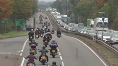 Traffic jam as motorcyclists and bikers ride along dual carriageway in England Stock Footage