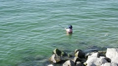 Catching fish in the Sea of Galilee Stock Footage