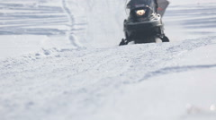 Snowmobile accelerating in the sunshine Stock Footage
