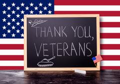 Greeting card with handwriting text thank you veterans and  painted tank, pla Stock Photos