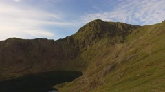 Panning shot of Mount Snowdon and its reservoir. Stock Footage