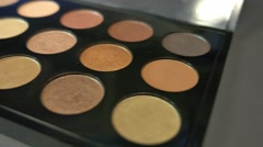 A footage moving from right to left showing a make up palette and some brushes Stock Footage