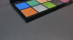 Footage of a colorful make up palette, the shot is moving from left to right Stock Footage