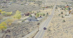 Car driving on country road in a desert town in topaz lake, USA Stock Footage