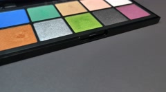 Footage of a colorful make up palette, the shot is moving from right to left Stock Footage