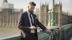 4K Portrait smiling London businessman talking on phone outdoors in the city Stock Footage