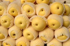 Fresh pear fruit symmetrically stacked Stock Photos