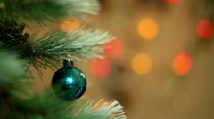 Christmas ball on the tree on the background of colored lights out of focus. Stock Footage