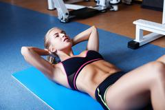 Girl exercising abs Stock Photos