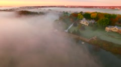 Surreal landscape at dawn over foggy autumn river Stock Footage