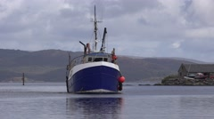 BLUE TRAWLER ENTERING HARBOUR Stock Footage