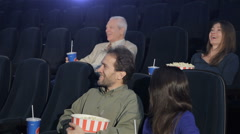 People watch comedy at the movie theater Stock Footage