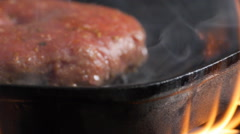 Burger in a grill pan with smoke, slide camera close up Stock Footage