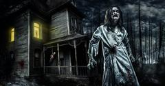 Horror zombie near the abandoned house. Halloween. Stock Photos