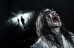 The shouting female zombie Stock Photos