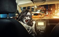 Undead girl with bloody face rides in the car Stock Photos