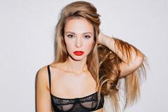 Female in transparent bra holding her hair Stock Photos