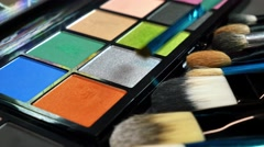 Close up footage of a make-up palette and a person using a color from it Stock Footage