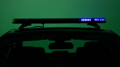 Police car lights on green screen Stock Footage