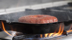 Hamburger in a grill pan with smoke, slide camera Stock Footage