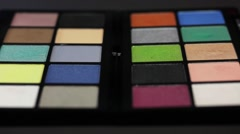 Two make up palettes standing next to each other, the shot is coming into focus Stock Footage