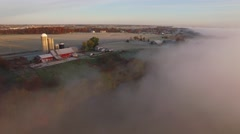 Surreal landscape at dawn over foggy autumn river, Fall colors adorning shore Stock Footage