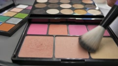 Low angle footage of a make-up artist using her palette Stock Footage