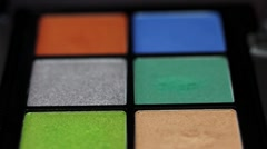 Extreme DOF and a close up of a make up palette,shot is moving from its bottom Stock Footage