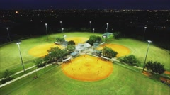 Cool Aerial shot flying over baseball parks in the evening during game Stock Footage