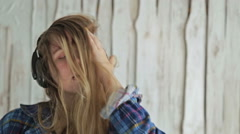 Woman listening to music, dancing and closing face by long hair Stock Footage