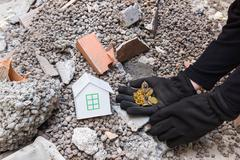 Exploiter thief loots a house devastated by earthquake Stock Photos